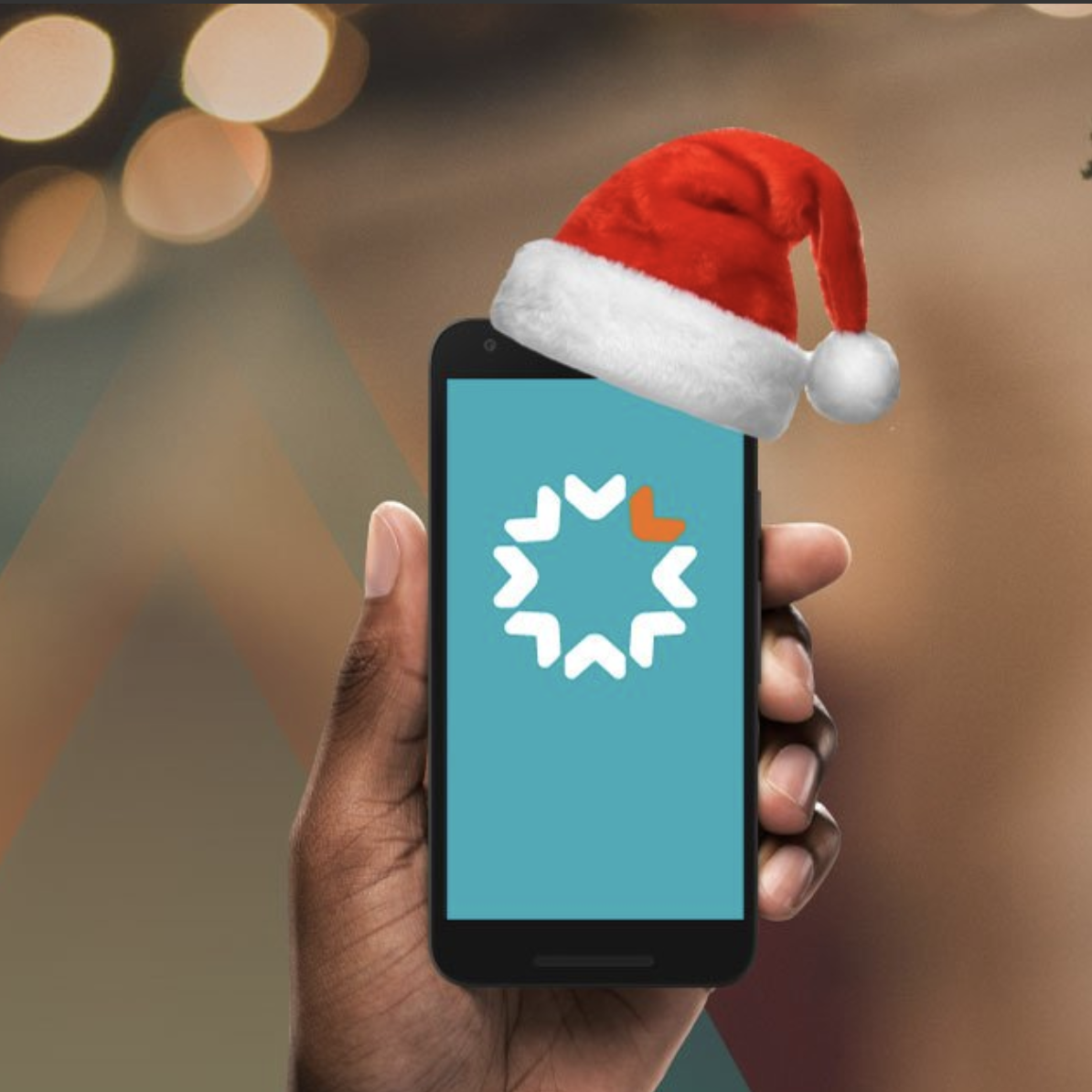 A phone with a Christmas hat on